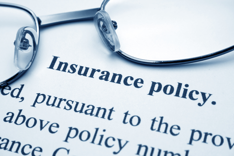 Close up of glasses on Insurance policy contract language