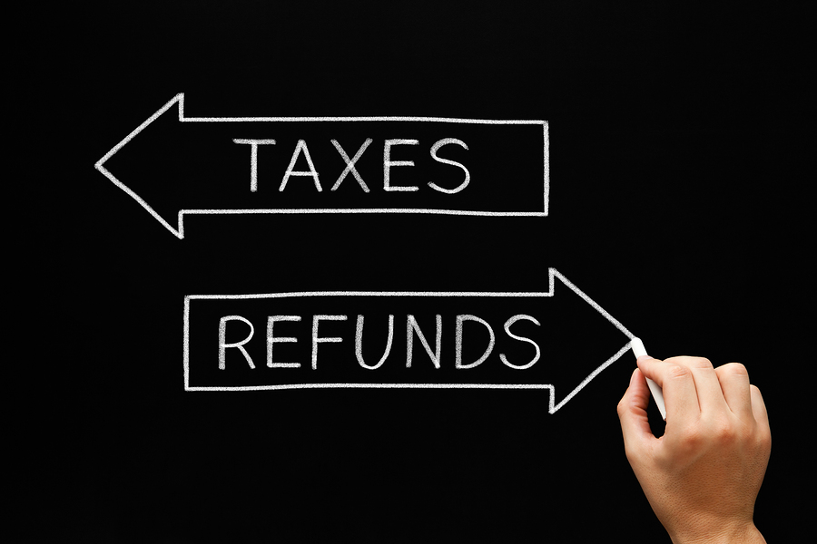 Taxes Refunds Arrows Concept Blackboard