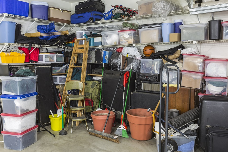 Residential garage full of junk and storage downsizing