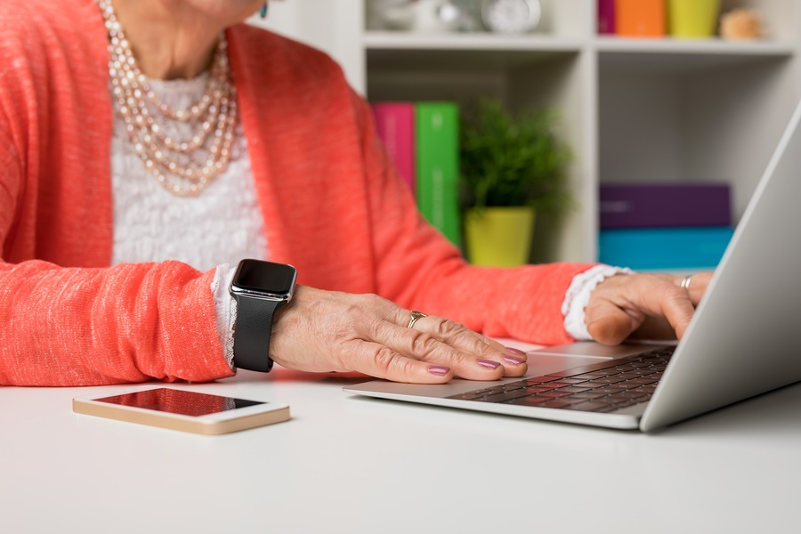 long term care ombudsmen advocating for seniors older woman working at a laptop