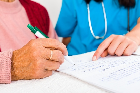 woman signing a Contract With Nursing Home