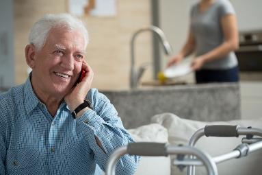 technology older man talking on the phone