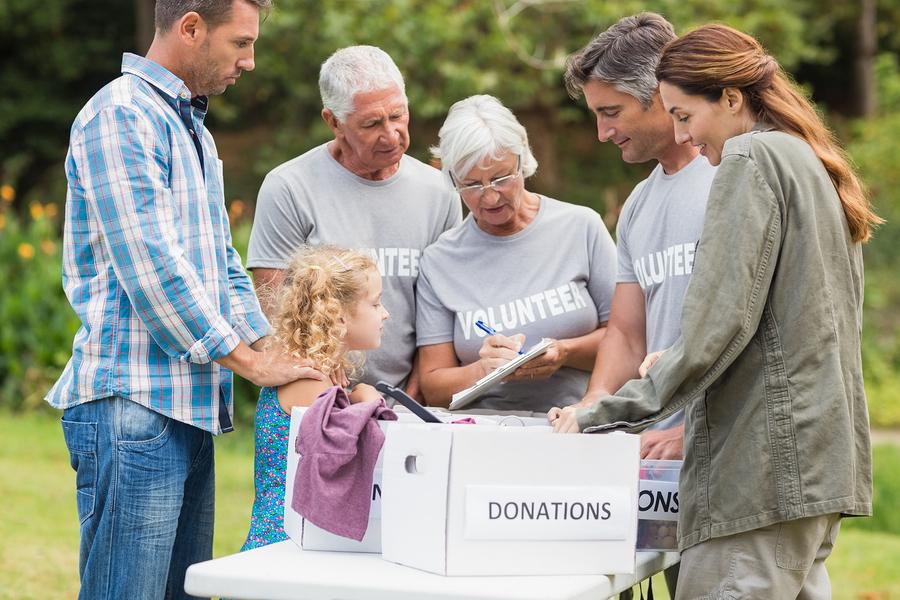 senior volunteers separating donations stuff