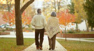 Elderly couple walking in autumn park