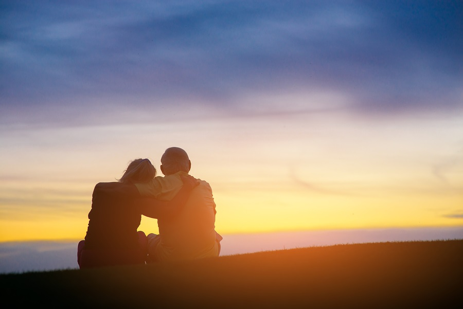 end of life planning Couple on evening sky background