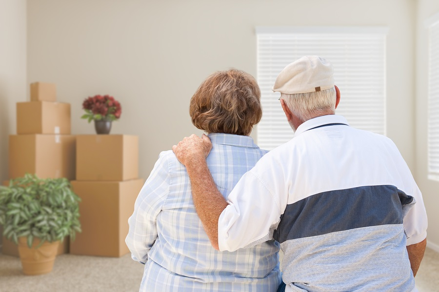 moving to a CCRC older couple with moving boxes
