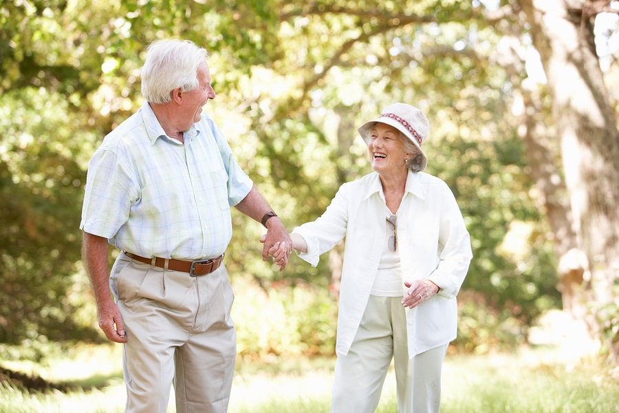 future of senior living older couple outdoors holding hands