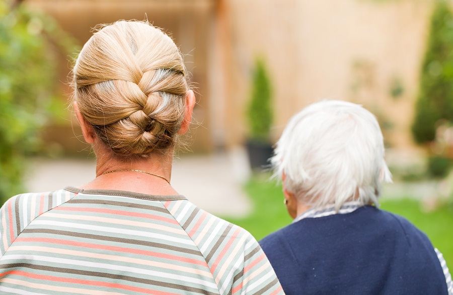 the cost of caring for an elderly parent older woman walking with her elderly mother