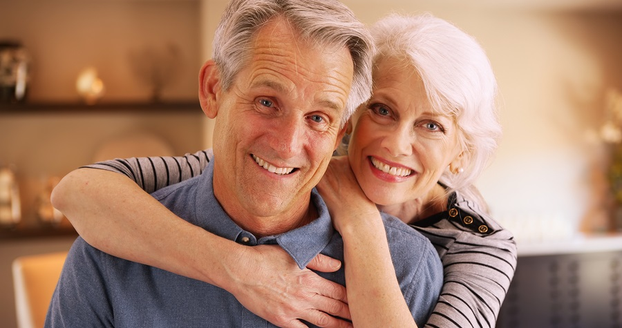 attracting younger retirees older couple embracing