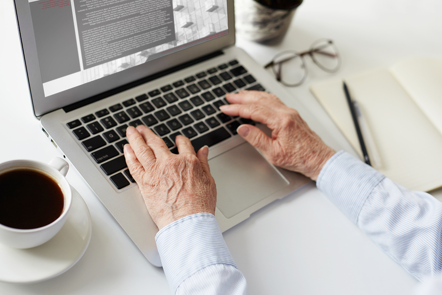 encore career older person using a laptop