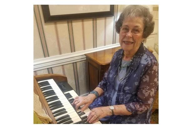 senior woman playing the organ