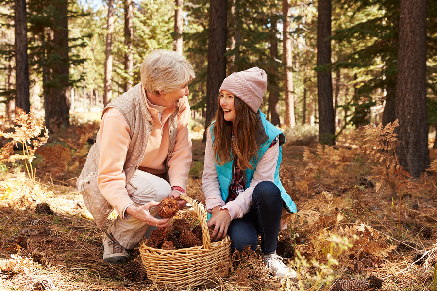 intergenerational programs older woman and teen girl in the woods UNSPLASH
