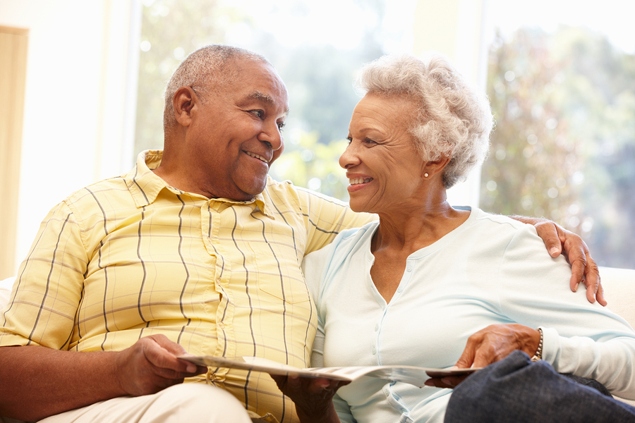 CCRC happy older couple cuddling on a sofa