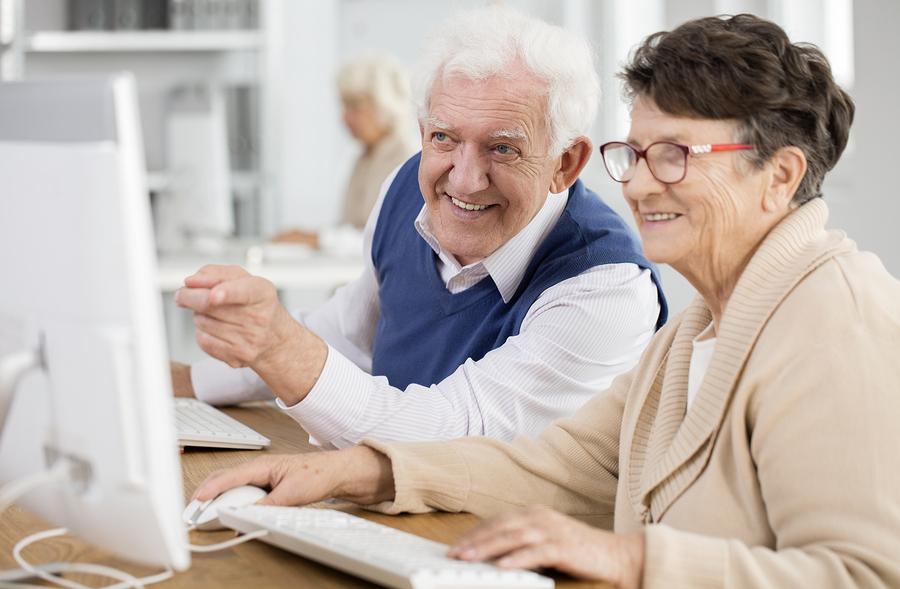 lifelong learning seniors looking at a computer