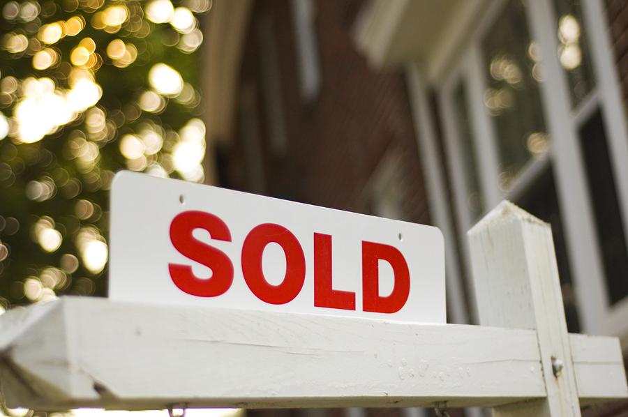 real estate sold sign