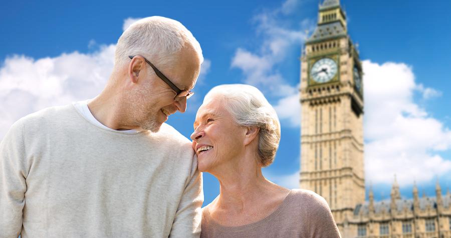 happy senior couple looking at big ben