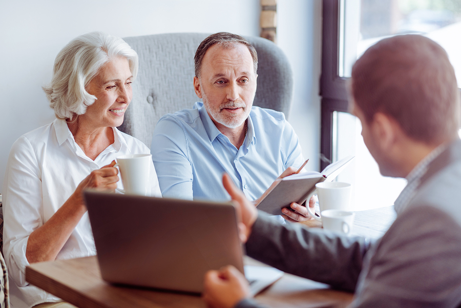 financial planner with clients