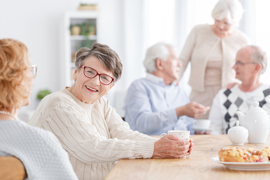 group of older people socializing at a table