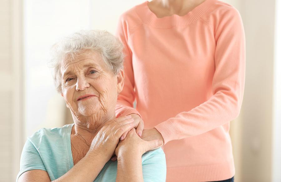 Woman hugging old woman