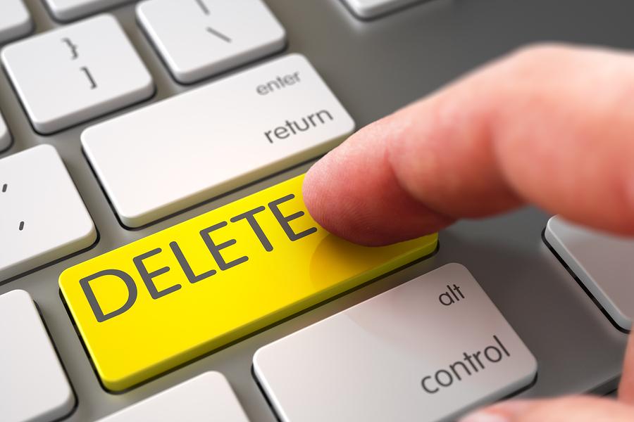 Computer User Presses Delete Key