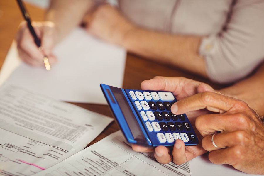 Close up of senior couple calculating CCRC expenses