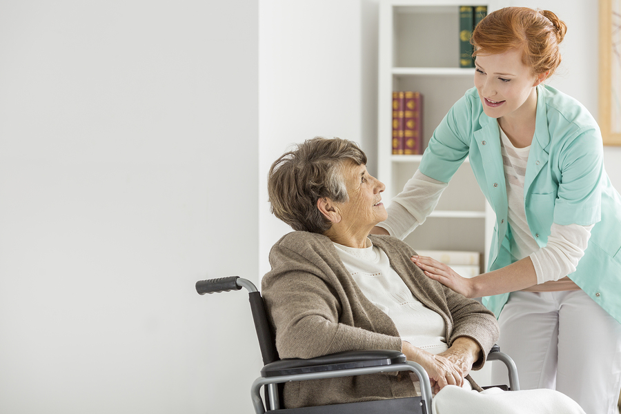 Caregiver helping elderly woman In her Home