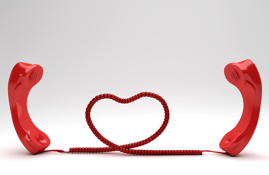 Long Distance caregiving concept with red phones