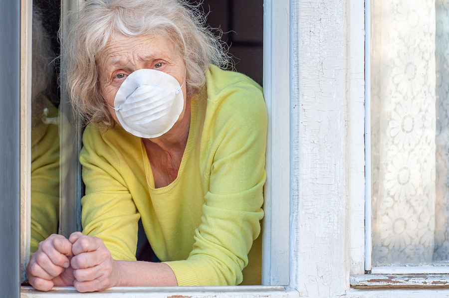 Elderly Woman Breathes Fresh Air Through The Window aging in place