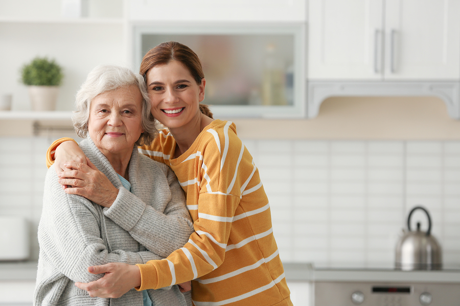 family caregiving Elderly Woman With Female Caregiver In Kitchen