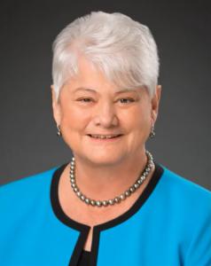 Dr. Karen Wilson headshot; history of senior living
