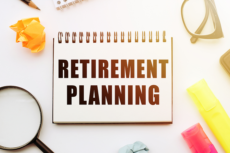 Retirement Planning, Text In Notebook On White Table With Office