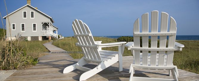 Chairs On Deck Facing Ocean second home for retirement