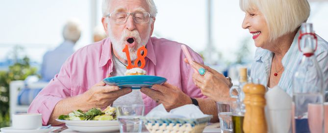 positive aging; Happy Senior Man Celebrating His Birthday