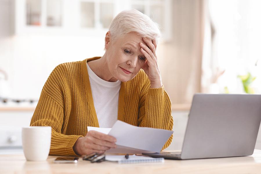 single seniors ; single older woman paying bills